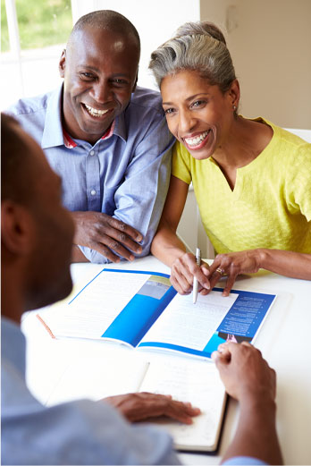 A couple seeking help from an advisor on how to manage their income tax in retirement.